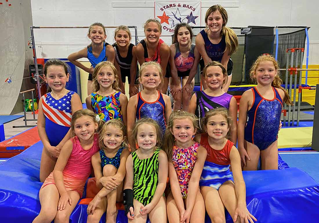 colorful group of young gymnasts