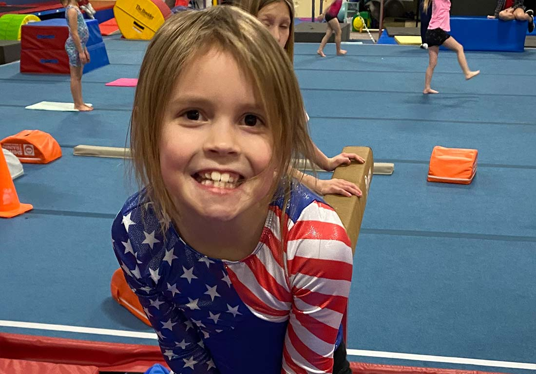 young gymnast in american outfit